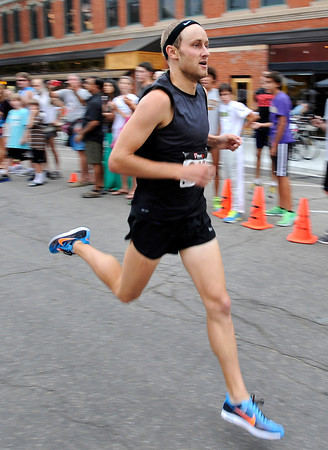 "during the Pearl Street Mile race on Thursday, Aug. 9, in Boulder.For a video of the race go to  <a href=""http://www.dailycamera.com"">http://www.dailycamera.com</a><br /> Jeremy Papasso/ Camera"