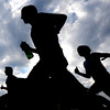 "Racers in the family division are silhouetted by the sky during the Pearl Street Mile on Thursday, Aug. 9, in Boulder. For a video of the race go to  <a href=""http://www.dailycamera.com"">http://www.dailycamera.com</a><br /> Jeremy Papasso/ Camera"