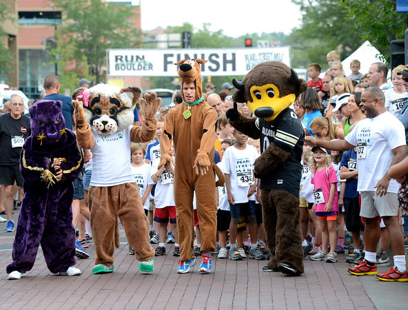 "The mascots including Ryan Van Duzer, center, warm up for the their race during the Pearl Street Mile on Thursday, Aug. 9, in Boulder. For a video of the race go to  <a href=""http://www.dailycamera.com"">http://www.dailycamera.com</a><br /> Jeremy Papasso/ Camera"