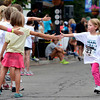 "Lauren Kristoff, 4, at right, slaps the high-five's some spectators as she nears the finish line during the kids race at the Pearl Street Mile on Thursday, Aug. 9, in Boulder.For a video of the race go to  <a href=""http://www.dailycamera.com"">http://www.dailycamera.com</a><br /> Jeremy Papasso/ Camera"