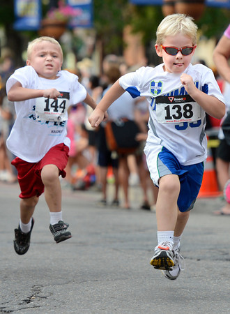 "kids speed to the finish line while racing in the kids division during the Pearl Street Mile on Thursday, Aug. 9, in Boulder. For a video of the race go to  <a href=""http://www.dailycamera.com"">http://www.dailycamera.com</a><br /> Jeremy Papasso/ Camera"