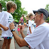 "David Lotz, of Boulder, pins a race bib on his daughter Elena, 7, before the start of the kids race during the Pearl Street Mile on Thursday, Aug. 9, in Boulder. For a video of the race go to  <a href=""http://www.dailycamera.com"">http://www.dailycamera.com</a><br /> Jeremy Papasso/ Camera"