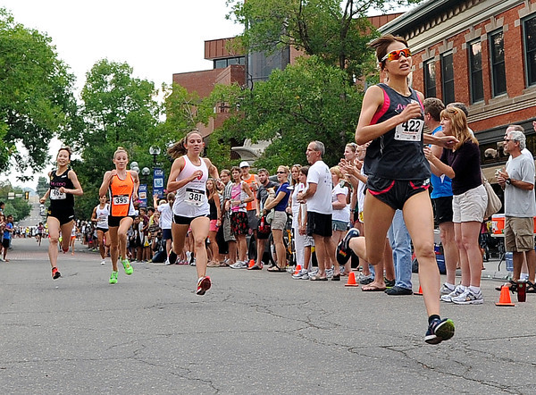 "Chihiro Sunaga, of Japan, right, speeds towards the finish line ahead of her competitors during the competitive women's race at the Pearl Street Mile on Thursday, Aug. 9, in Boulder. Sunaga won the race. For a video of the race go to  <a href=""http://www.dailycamera.com"">http://www.dailycamera.com</a><br /> Jeremy Papasso/ Camera"