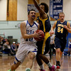 MARY SCHWALM/Staff photo Pelham's Jake Vaiknoras (10) drives to the basket against the ConVal defense during their basketball game in Pelham. 1/8/14
