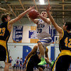 MARY SCHWALM/Staff photo Pelham's Mike Pelletier splits the ConVal defense as he puts up a shot during their basketball game in Pelham. 1/8/14