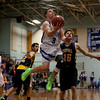 MARY SCHWALM/Staff photo Pelham's Joe Slattery soars to the basket against the ConVal defense during their basketball game in Pelham. 1/8/14