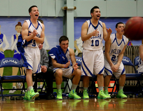 MARY SCHWALM/Staff photo Pelham players including Joe Slattery (3) and Jake Vaiknoras (10) cheer for their teammates from the bench late in their 76-47 win over ConVal in their basketball game in Pelham1/8/14