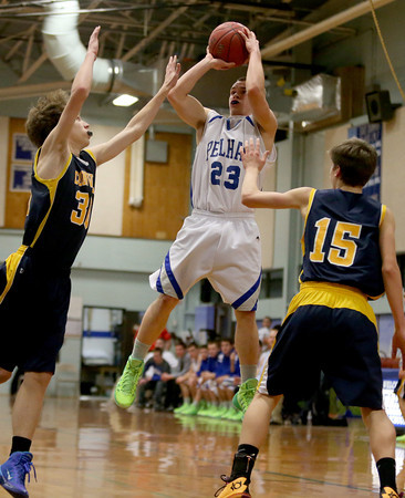 MARY SCHWALM/Staff photo Pelham's Mike Pelletier (23) takes a shot against the ConVal defense during their basketball game in Pelham. 1/8/14
