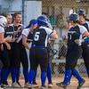 Peniel freshman Rylee Romay (1) is greeted by her teammates after she knocked one over the fence for her first home run in the district semifinal game against FAMU on Thursday night. Fran Ruchalski/Palatka Daily News