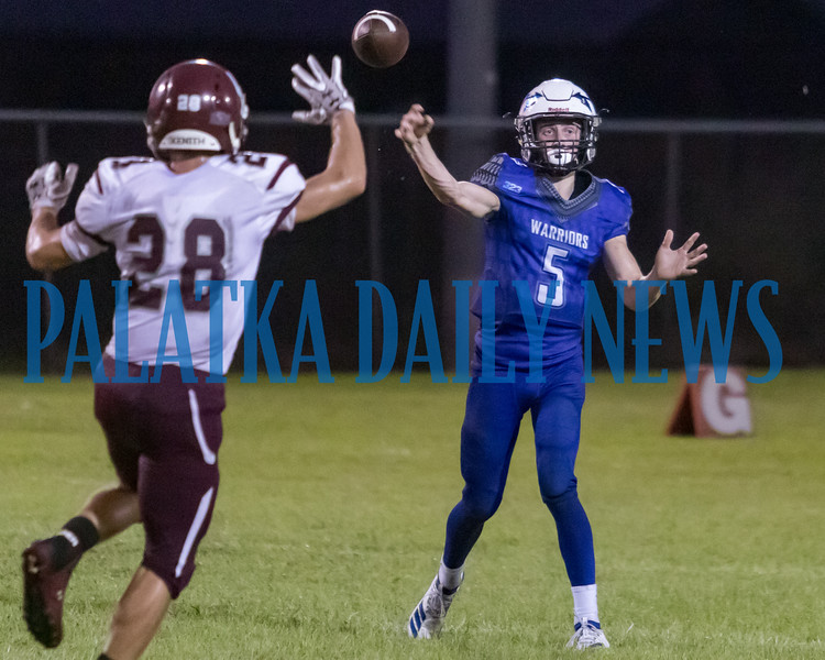 Peniel senior Andrew Dennin (5) launches a pass in the first half in the game against Old Plank. Fran Ruchalski/Palatka Daily News