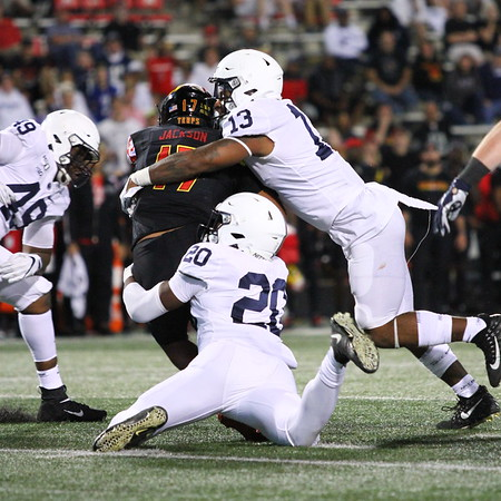 Penn State defenders #13 Ellis Brooks and #20 Adisa Isaac sack Maryland QB #17 Josh Jackson