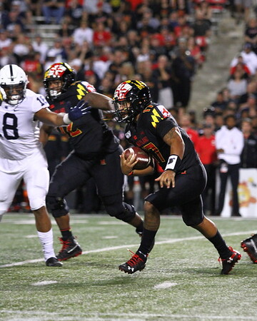 Maryland QB #17 Josh Jackson rushes with the ball