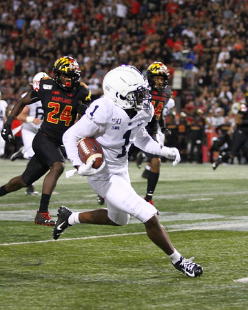 Penn State WR #1 KJ Hamler runs after a catch