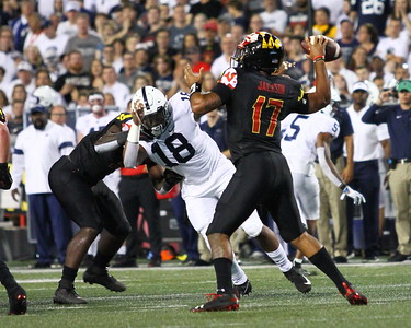 Maryland QB #17 Josh Jackson makes a pass under pressure from Penn State DE #18 Shaka Toney