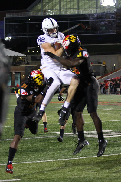 Penn State TE #82 Zack Kuntz unsuccessfully attempts to hurdle a Maryland defender.