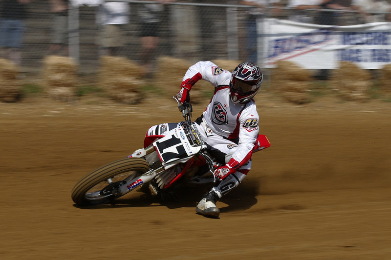 I spend quite a bit of time at corner one at the Peoria TT's trying to get shots like this.  Slow shutter speeds and panning with the riders to get a good background blur.  This is so close to be straight out of the camera it's crazy.