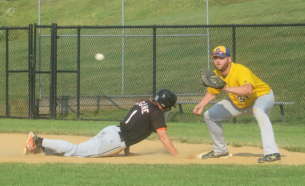 . Collegeville\'s Jon McGlone safely slides into first before Ambler\'s Nick Fasanocan tag him out.  Thursday, July 31, 2014.  Photo by Adrianna Hoff/Times Herald Staff.