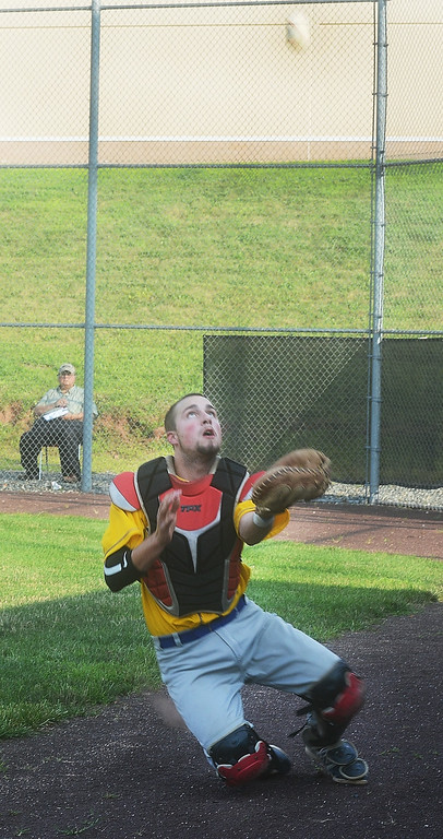 . Ambler\'s catcher Kyle Scannell catches a foul ball.  Thursday, July 31, 2014.  Photo by Adrianna Hoff/Times Herald Staff.
