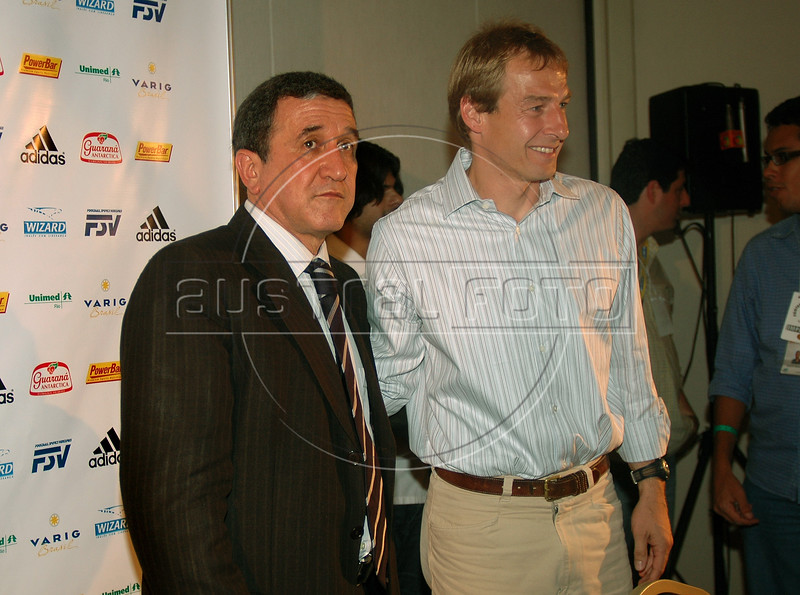 Juergen Klinsmann, right, head coach of the German national football team and Carlos Alberto Parreira, left, Brazil's coach, pose to journalists after a news conference at the II Internacional Football Forum in Rio de Janeiro, Brazil, Dec. 1, 2005.  (Austral Foto/Renzo Gostoli)