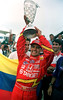 Winner of the Rio 200, Colombian driver Juan Pablo Montoya raises a trophy given to him by Colombian fans at the Emerson Fittipaldi Oval in Rio de Janeiro, Brazil, May 15, 1999. Montoya set a CART record by becoming the first rookie to win three consecutive races. (Austral Foto/Renzo Gostoli)