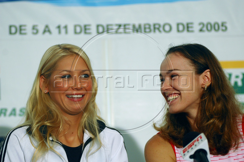 Tennis players Martina Hingis, right, from Switzerland and Russia's Anna Kournikova, left, talk with journalists during a press conference in Rio de Janeiro, Brazil, Dec. 9, 2005. Hingis and Kournikova will play an exhibition game in Copacabana Beach on Saturday, Dec. 10.  (Austral Foto/Renzo Gostoli)