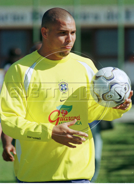 Ronaldo carries a  soccer ball upon arriving for training with the Brazilian national team in Teresopolis, about 100 miles north of Rio de Janeiro. (Australfoto/Douglas Engle)