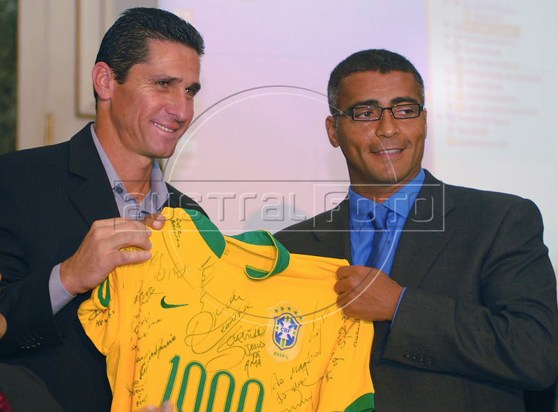 Brazilian soccer star Romario, right, receives from former teammate Jorginho a Brazilian national team shirt signed by the country's top players for his '1000th' goal in Rio de Janeiro, Brazil, May 24, 2007. Romario, scored the 1,000th goal at his own count on 20 May, playing for Vasco da Gama in the Brazilian championship. (Austral Foto/Renzo Gostoli)