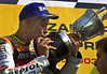 Italian rider Valentino Rossi of the Repsol Honda racing team kisses the trophy at the podium after winning the MotoGP category of the Cinzano Rio Grand Prix at the Nelson Piquet racetrack in Rio de Janeiro, Brazil, Sept. 20, 2003. (Austral Foto/Renzo Gostoli)