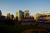 Petco Park Stadium with the sun setting on the buildings