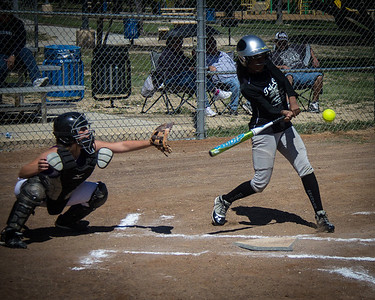 Azia puts the bat on the ball in the first inning