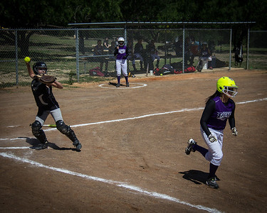 Hannah throws to first after a missed third strike