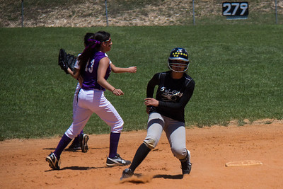 Jasmine puts on the breaks after rounding second base in the first inning