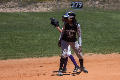 Azia watches for the ball after stealing second base