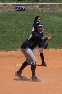 Jasmine tries to draw a throw from the catcher
