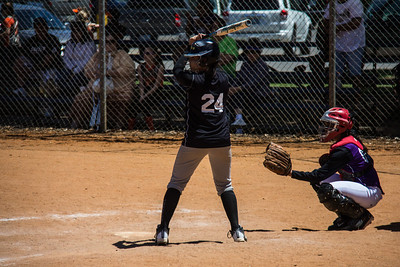 Jasmine waits for her pitch in the first inning, but ends up getting hit in the hand instead