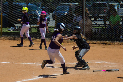 Hannah goes for the tag at home plate