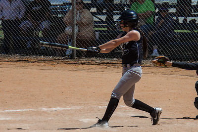 Erika take a big cut at a pitch in the first inning