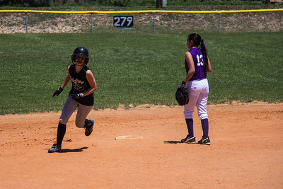 Hannah rounds second base in the first inning