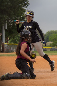 Jasmine gets out of the way of an inside pitch before drawing a walk in the first inning