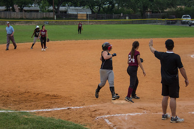 Addison reaches third base after Azia pulls into second base with a double