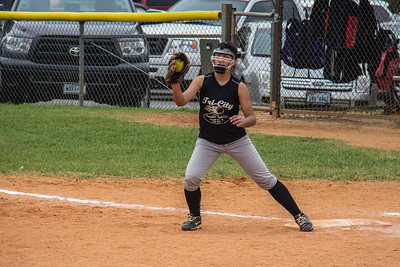 Alina hauls in the throw at first base