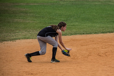 Micaylah fields the grounder at shortstop