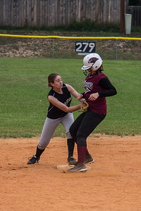 McKenna applies the tag a hair too late at second base