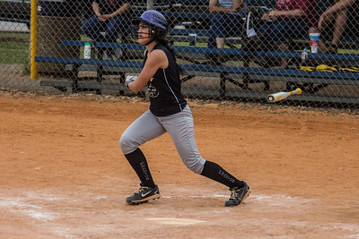 Alina levitates her bat after a lead-off single