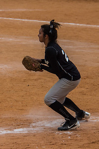 Jasmine fields a grounder at third base