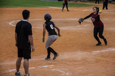Alina moments before she safely retreats to third base after drawing the throw from the pitcher