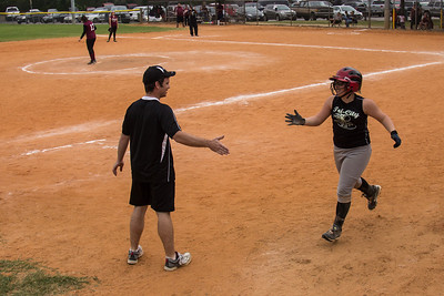 Coach Chris gives Addison a high five on her way back to the dugout