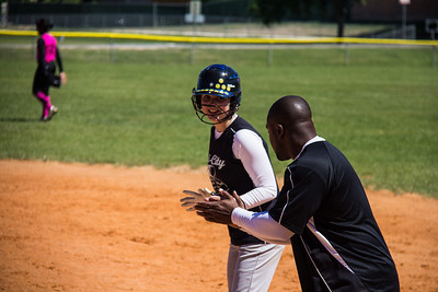 Rylee and Coach Bryant talk base running