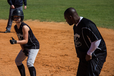 Hannah gives Coach Bryant the thumbs up after drawing the base on balls
