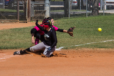 Addison slides into third base